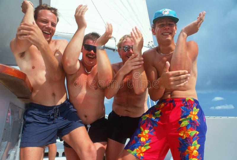 Turistas alemanes partying en la playa foto de archivo libre de regalías