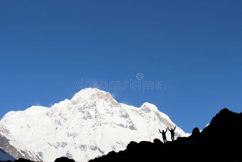 Turistas en el campo bajo de Annapurna imágenes de archivo libres de regalías