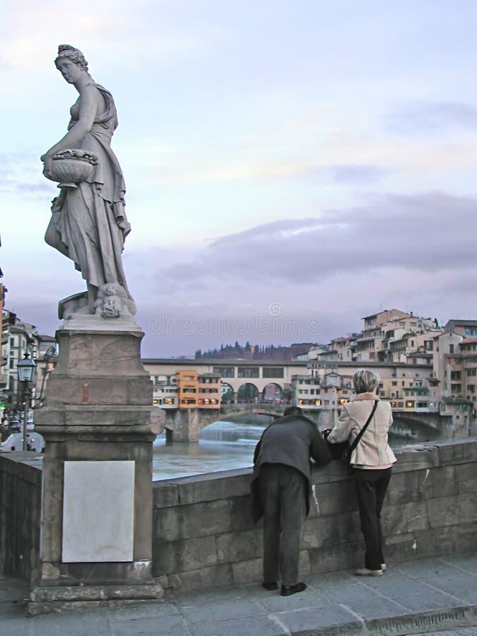 Turistas que toman las fotos