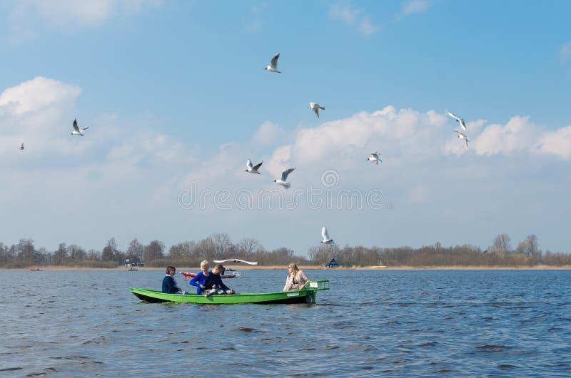 Turister i litet fartyg royaltyfria bilder