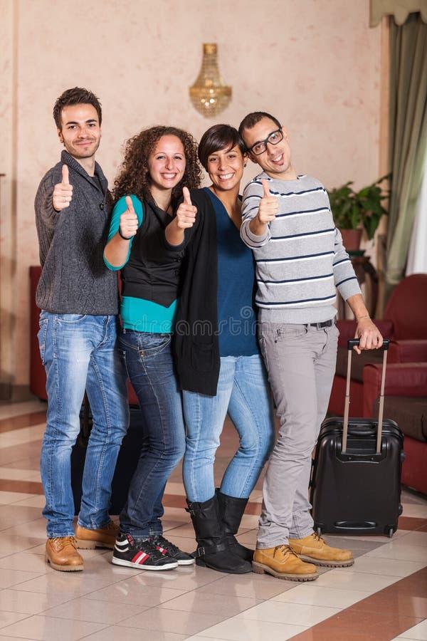 Turister med tum upp royaltyfri fotografi
