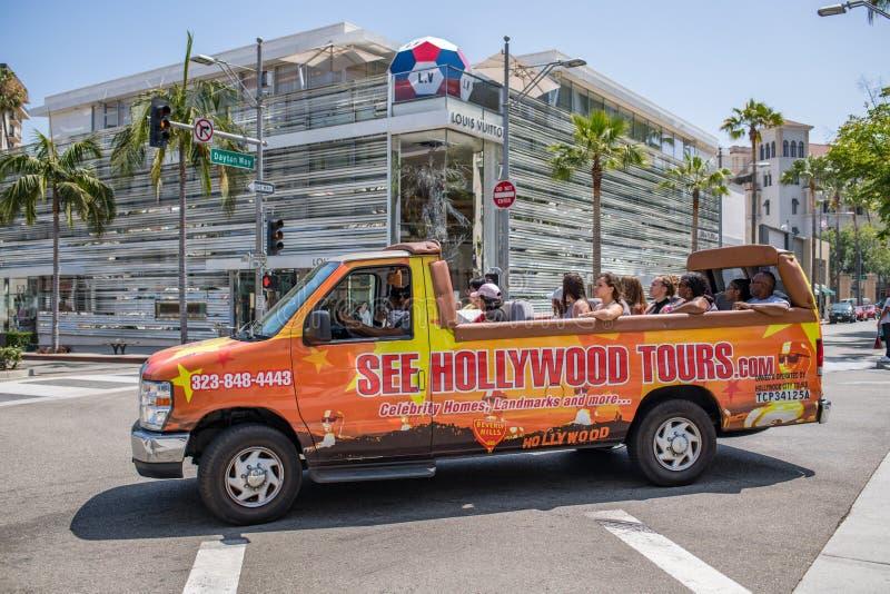 Turister turnerar på bussen/skåpbilen i rodeodrev fotografering för bildbyråer
