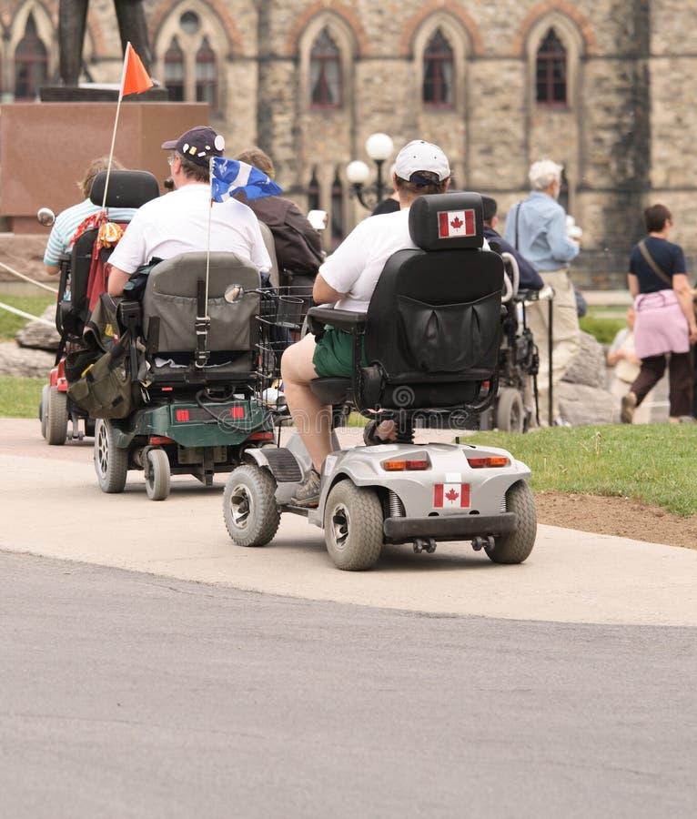Turisti elettrici della presidenza di rotella immagine stock libera da diritti