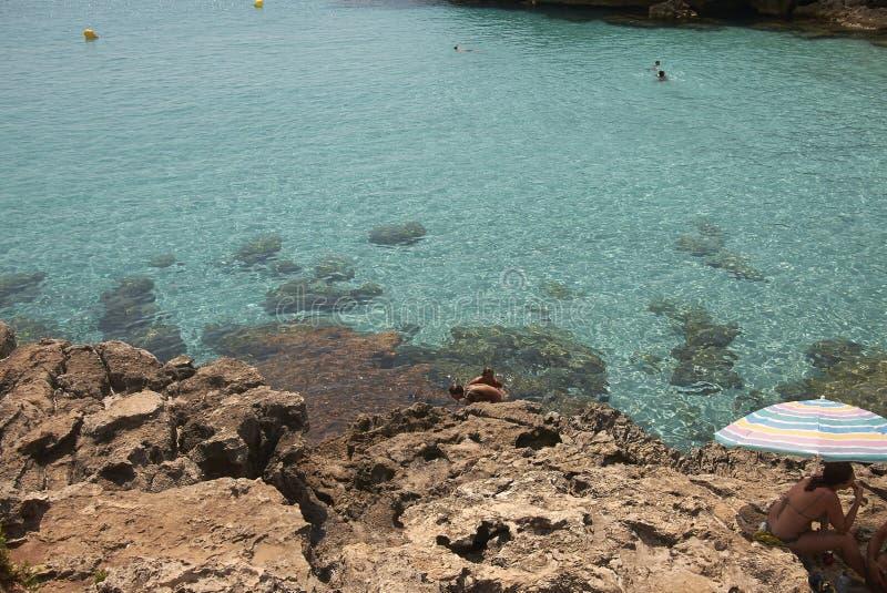 Turisti Playa Sa Olla immagini stock libere da diritti