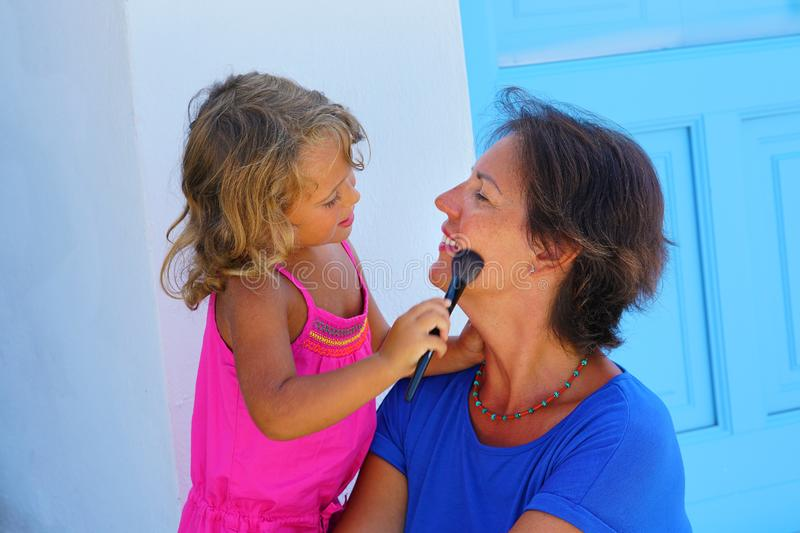 Turists in Santorini are happy to wear makeup during their holidays in Greece stock photo
