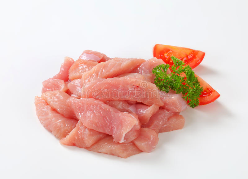 Turkey breast strips. Diced turkey breast on white background stock photos