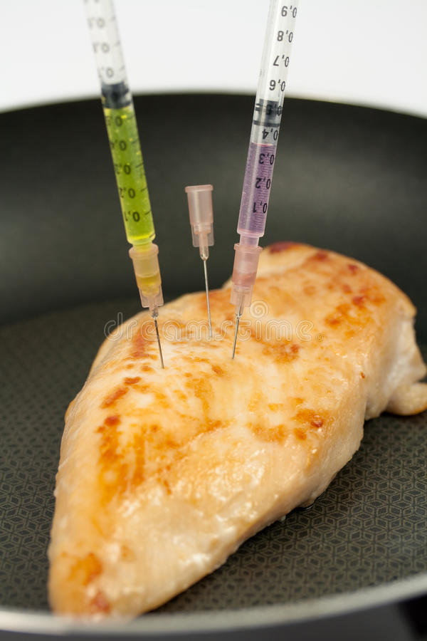 Turkey breast with syringes stock photography