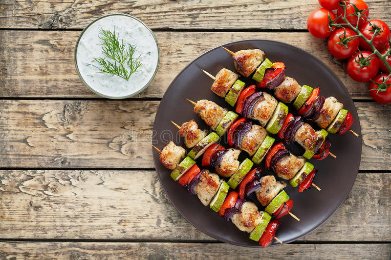 Turkey or chicken meat kebab skewers with tzatziki sauce royalty free stock photo