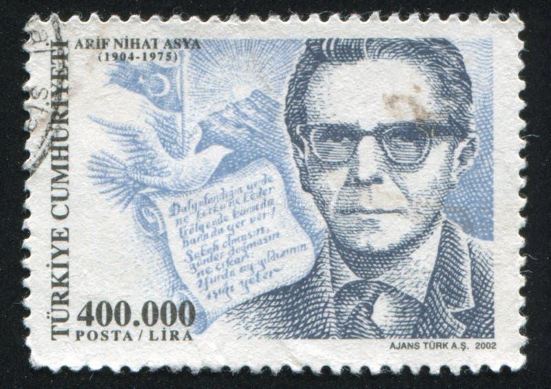 Arif Nihat Asya. TURKEY- CIRCA 2002: stamp printed by Turkey, shows Arif Nihat Asya, writer, circa 2002 stock photography
