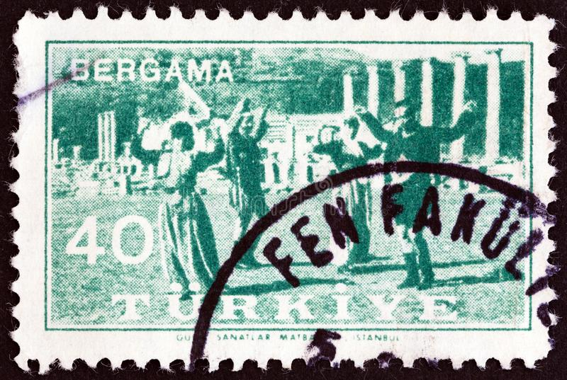 TURKEY - CIRCA 1957: A stamp printed in Turkey shows folk dancing, circa 1957. TURKEY - CIRCA 1957: A stamp printed in Turkey from the `Bergama Fair ` issue royalty free stock images