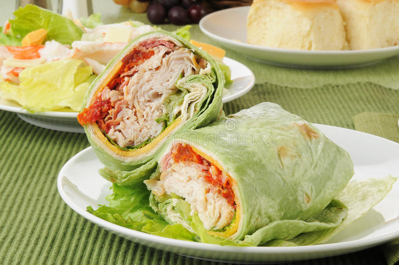 Turkey club sandwch with a salad royalty free stock image