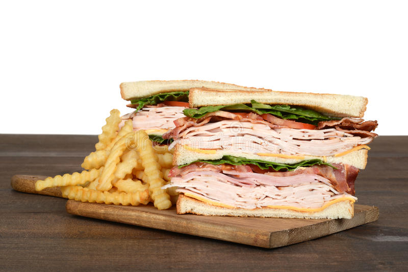 Turkey club sandwich with french fries stock images