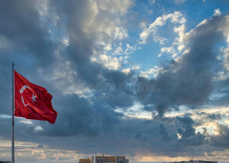 Turkey flag with clouds background. Turkey flag with beautiful clouds background stock photos