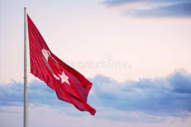 Turkey Flag surges above a cloudy evening sky.  stock image