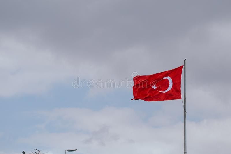 Turkey flag waving on the wind in the evening royalty free stock photo