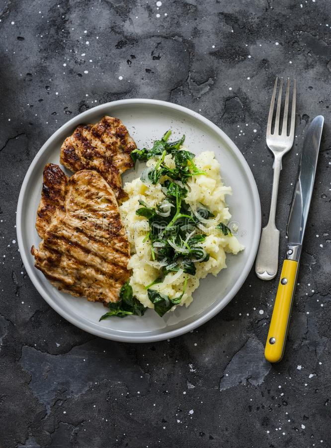 Free Turkey Grilled Chop And Mashed Potatoes With Butter Spinach On A Dark Background, Top View. Comfort Winter Autumn Home Cooked Food Stock Photo - 164405920