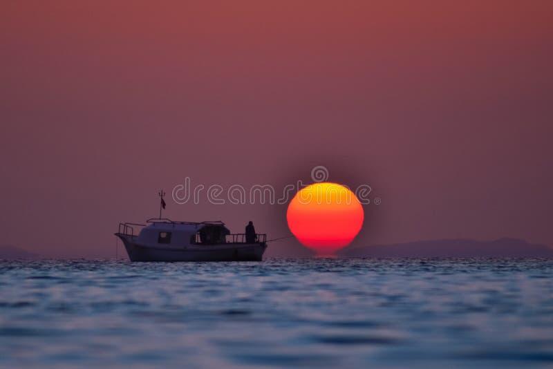 Turkey izmir sunset and fisherman boat royalty free stock photo