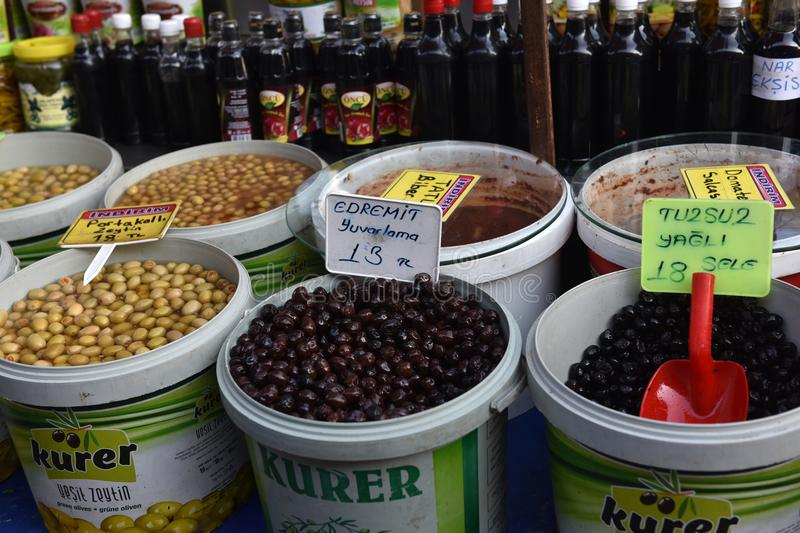 Olives in buckets on the market stock photo