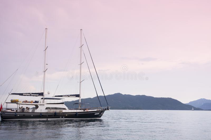 Turkey, Marmaris - June 20, 2019. Yacht parking in the sea at sunset in the background of the mountains in Marmaris bay stock photo
