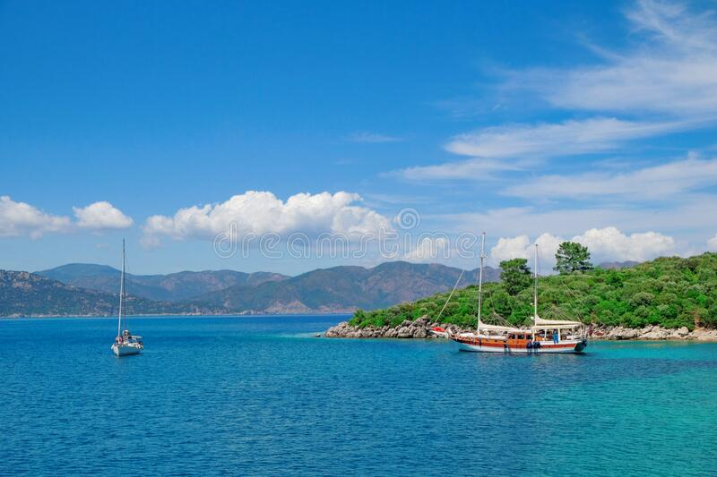 Turkey Mugla Marmaris Aegean sea. Boats in front of green mountains Turkish Mediterranean sea landscape. Yacht in Icmeler Turquois. Turkey Mugla Marmaris Aegean stock image
