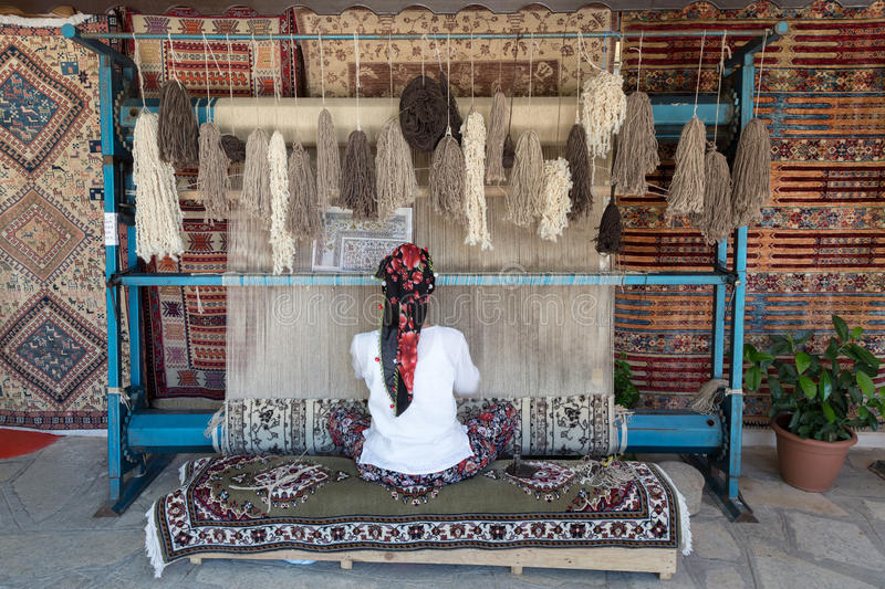 Turkey rug weave loom. By woman royalty free stock photography