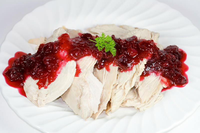 Turkey slices covered with cranberry sauce. stock photo