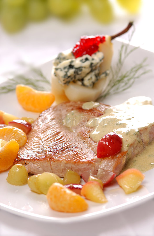 Turkey steak. With gorgonzola cheese and fruit stock image