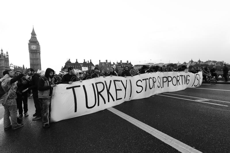Turkey stop supporting ISIS. LONDON, United Kingdom - OCTOBER 09, 2014: People appeal Turkey stop supporting ISIS in London with big ben, UK stock photo
