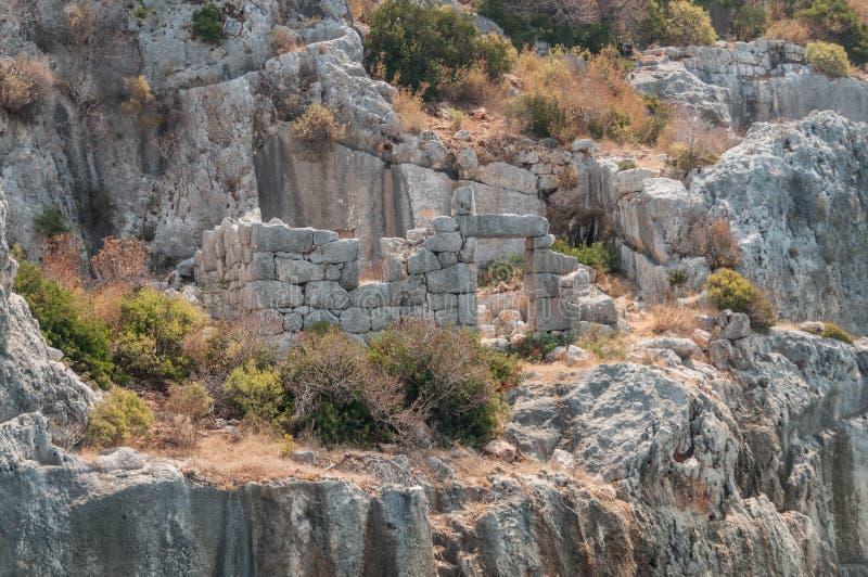 Turkije Mediterrane coastRuins van de oude die stad Kekova door een aardbeving wordt vernietigd stock afbeeldingen