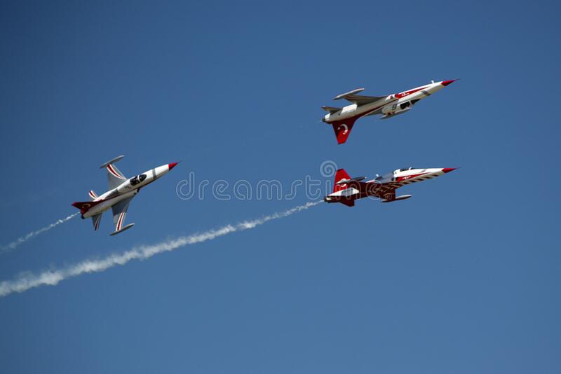 Turkish aerobatics team of NF-5A Freedom Fighter flying at air show. royalty free stock photo