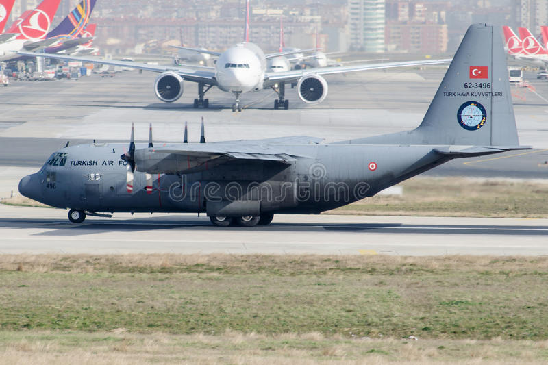 62-3496 Turkish Air Force, Lockheed C-130B Hercules. 62-3496 is rolling for take-off on runway 35R at Istanbul Ataturk Airport LTBA , February 6,2015 royalty free stock photos