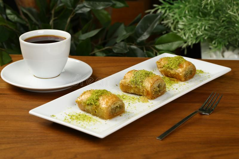 Baklava and coffee. Turkish baklava and coffee on the plate royalty free stock image