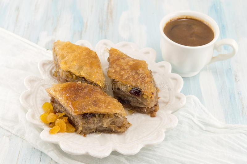 Turkish baklava dessert and coffee on a plate. Turkish baklava dessert and coffee on a white plate royalty free stock images