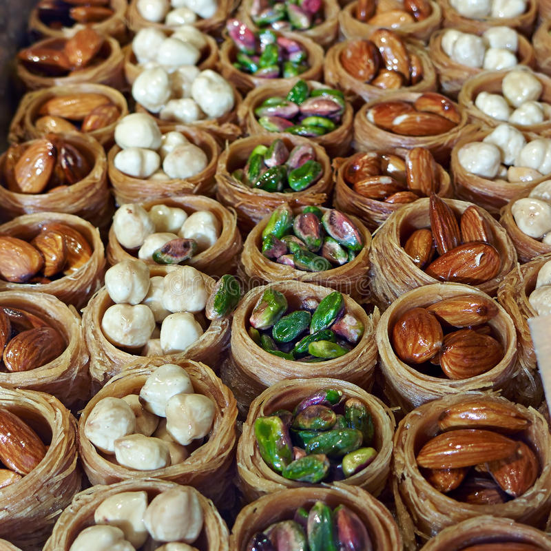 Turkish baklava. With nuts on showcase candy store. Food background stock images