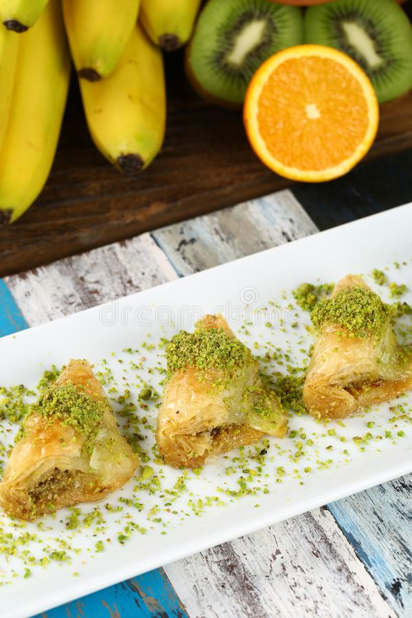 Baklava. Turkish baklava on the plate and beautiful background royalty free stock image