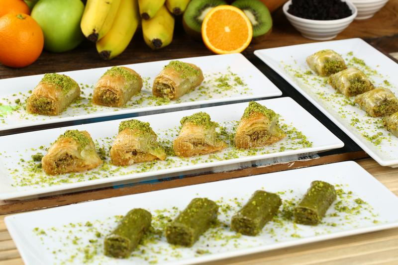 Baklava. Turkish baklava on the plate and fruits background stock photo