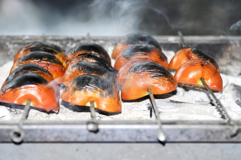 Tomatoes on barbecue (mangal) stock photos