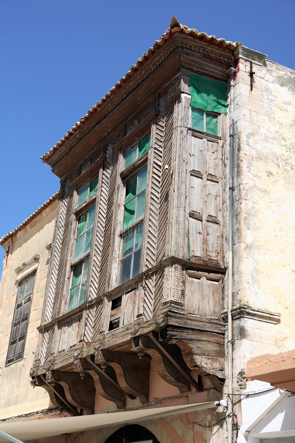 Turkish balcony architecture. A dilapidated Ottoman-era balcony in the old-town of Rethymnon, Crete, which is noted for its historic Mediterranean architecture stock image