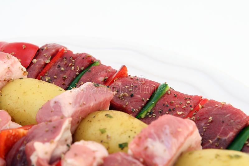 Turkish beef, lamb, and pork kebabs with potato on skewers stock photography