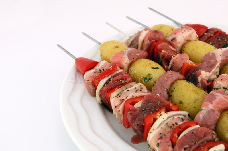 Turkish Beef, Lamb, And Pork Kebabs With Potato On Skewers Stock Photo