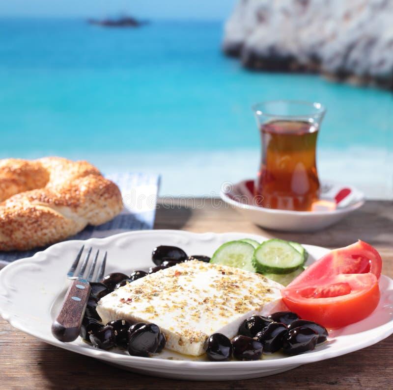 Turkish breakfast against a beach royalty free stock photos