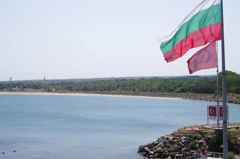Turkish and Bulgarian flags on the border. Turkish and Bulgarian flags in Rezovo on the border between Bulgaria and the European part of Turkey stock image