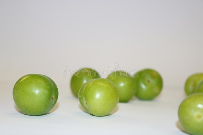 Turkish can erik. Fresh green plum fruit on white. Green and delicious sour plum. stock photography