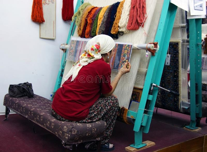 Turkish carpet factory. The process of hand weaving a carpet is shown royalty free stock photography