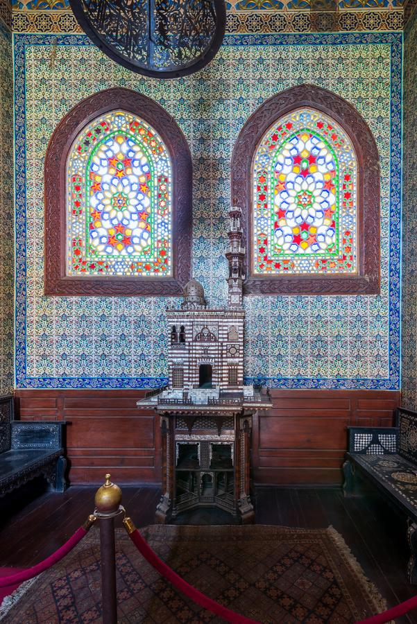 Turkish ceramic tiles wall and stained glass windows at Manial Palace of Prince Mohammed Ali, Cairo, Egypt. Turkish ceramic tiles wall, ornate ceiling and royalty free stock images