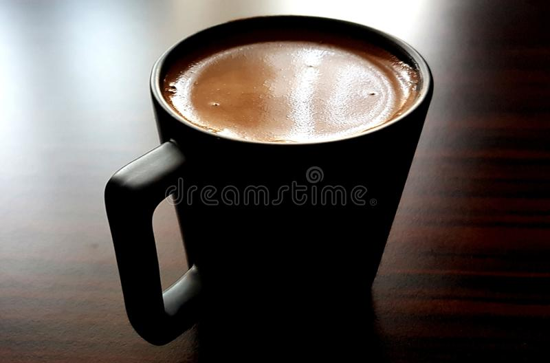 Turkish Coffee in black cup royalty free stock photography