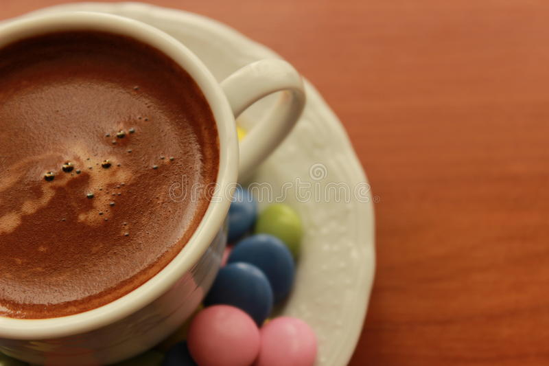Turkish coffee and candy chocolate. Turkish coffee and colored candy on the table stock photography