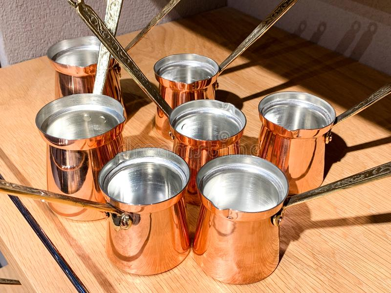 Turkish coffee cups to prepare traditional Turkish coffee made out of copper with a handle. Typcial gift or souvenir to bring from stock photography