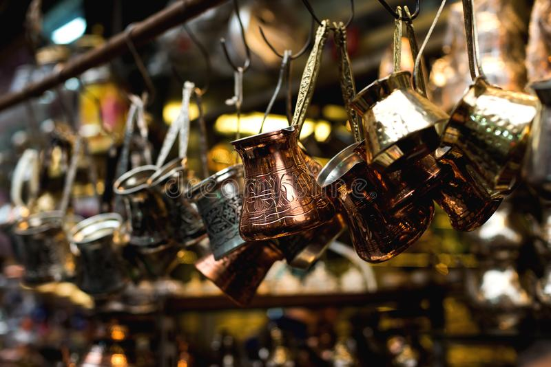 Turkish coffee pots, also know as ibrik, cezve, and briki in a street maket royalty free stock photo