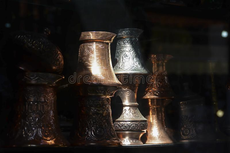 Traditional copper and silver-plated coffee pot souvenirs from Bosnia. Turkish coffee pots. Traditional copper and silver-plated coffee pot souvenirs from stock photos